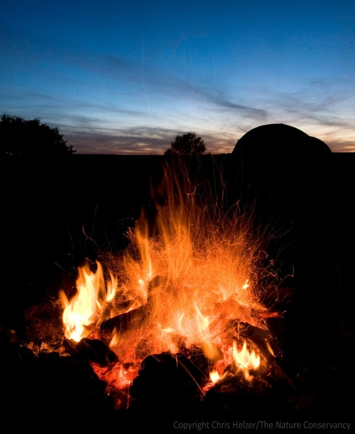 Camp fire at the Helzer prairie by Stockham, Nebraska.