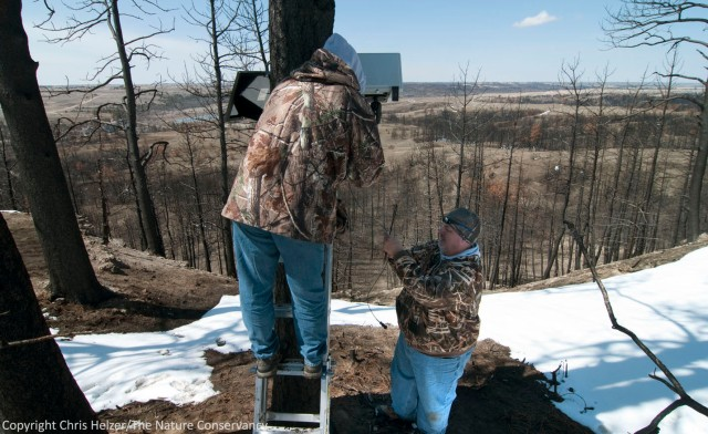 Jeff Dale and David Weber install a camera that will look straight down a steep slope in the burned pine woodland on the ridge north of the river.  Among other things, this camera will help capture evidence of any soil erosion that occurs over time.