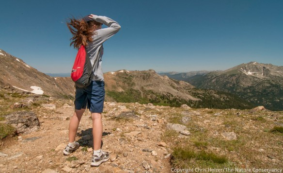 My daughter Anna had to hold on to her hat when we finally reached the top of the Pass.  The wind coming across the Continental Divide was enough to knock us over.
