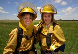 Anne Stine and Eliza Perry at their first prescribed fire.  The Nature Conservancy's Platte River Prairies, Nebraska.