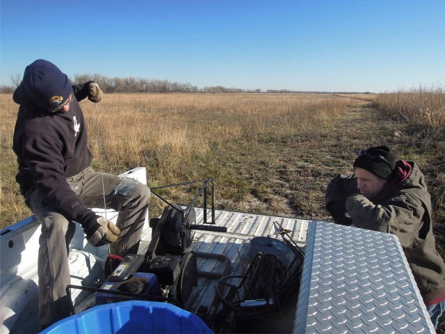 Pulling electric fence at the end of the season, using a motorized wire winder.