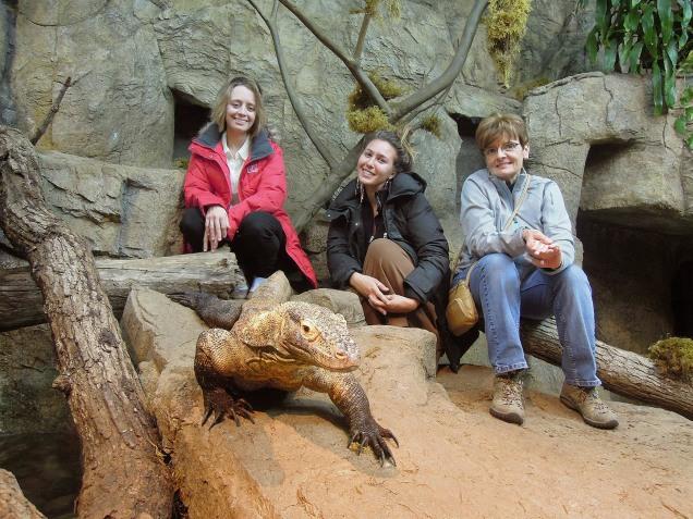 (L-R) Anne Stine, Eliza Perry, Anne Hubbard.  Monitor lizard in foregraound. Henry Doorly Zoo, Omaha, Nebraska.