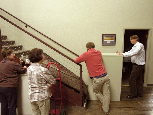 Staff at the Omaha field office of The Nature Conservancy - moving furniture.