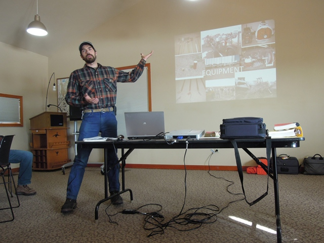 Land management professionals from various agencies and organizations got together at the Whooping Crane Trust for an annual fire refresher course. In this photo, Nelson is giving a presentation on fire equipment and safety. Photo by Eliza.