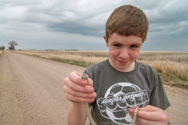 John was patient while I photographed the snake, but finally got his wish to pick it up and take a closer look himself.