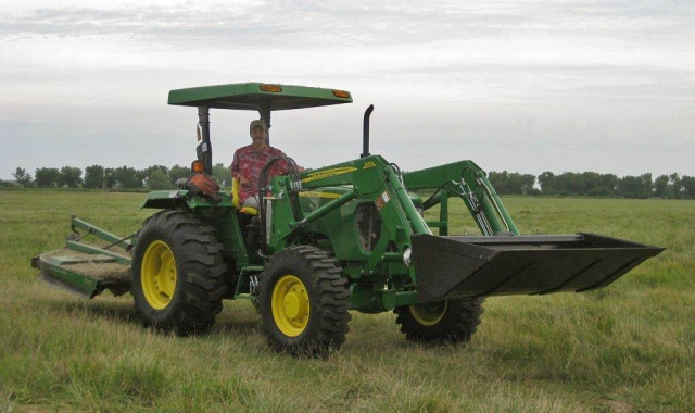 Dillon driving the John Deere.  Self portrait by Dillon Blankenship.