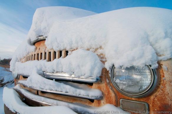 An old truck in a snowy prairie.  Leadership Center Prairie - Aurora, Nebraska.