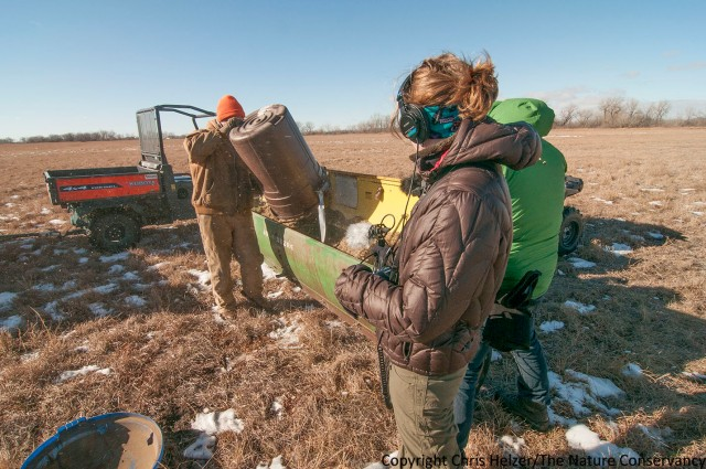 Ariana Brocious (with headphones) and Pete Stegen (green coat) collect audio and video footage as we prepare to overseed a degraded prairie back in January of this year.