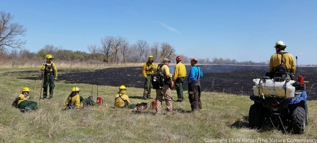 After the fire is over, the crew relaxes and discusses what went well and what didn't.