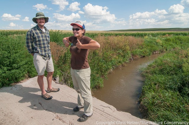 Hubbard Fellows Dillon Blankenship (left) and Jasmine Cutter stand near an irrigation ditch during a tour of Platte River irrigation activities.