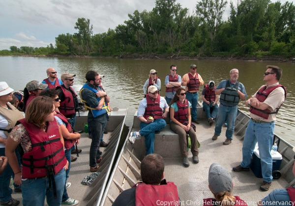 Kim Tri (bottom left) on a Missouri River boat tour in early June - part of a large conference of Nature Conservancy staff in Nebraska City.