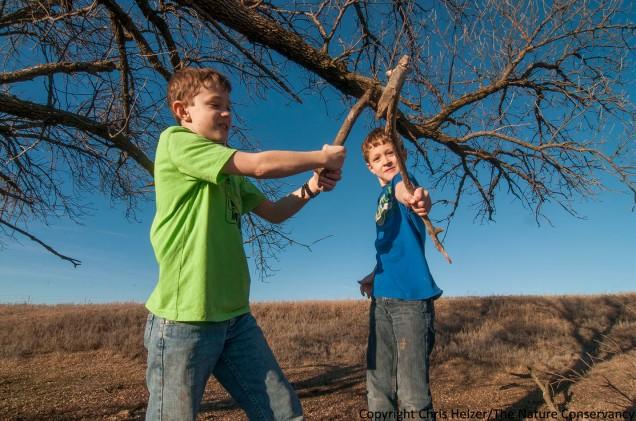 Boys with sticks. Helzer family prairie, Nebraska. Atticus (left) and Calvin Miller - stepsons of the photographer.