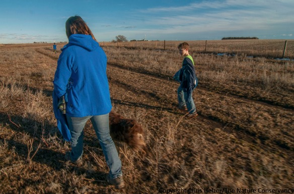 Outing at the Helzer family prairie, Nebraska. Kim Helzer with Atticus (left) and Calvin Miller - stepsons of the photographer.